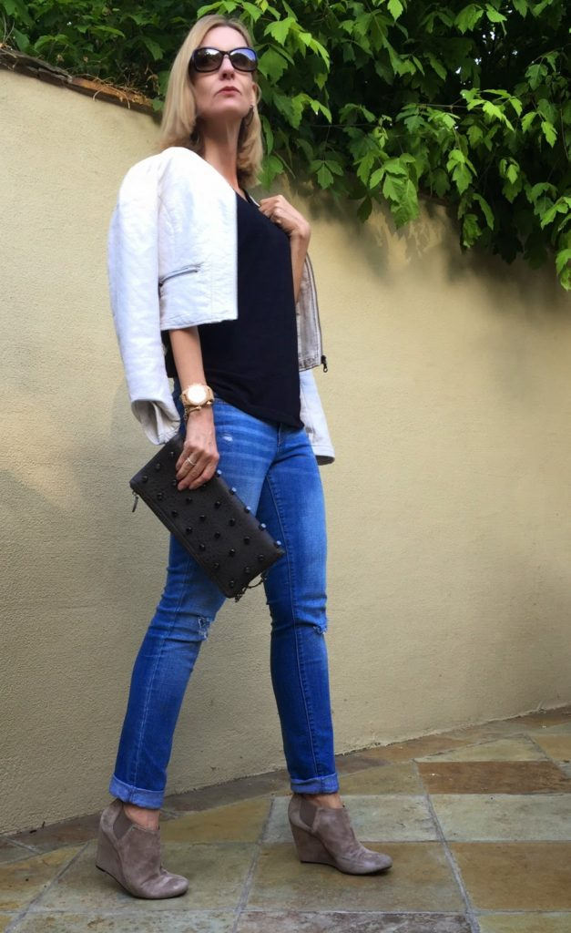 moto, distressed jeans, studded clutch, wood watch, suede booties, style over 40
