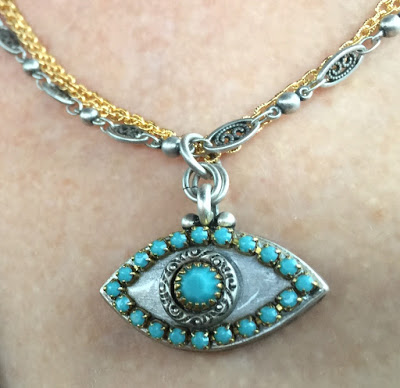 how to style an evil eye necklace
