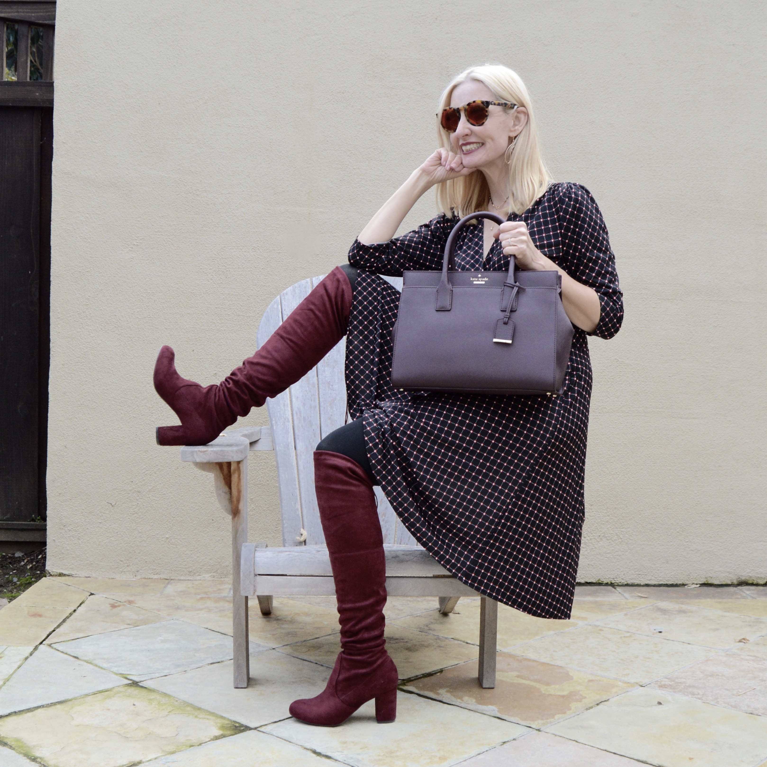 over the knee boots with a fit and flare dress and kate spade bag