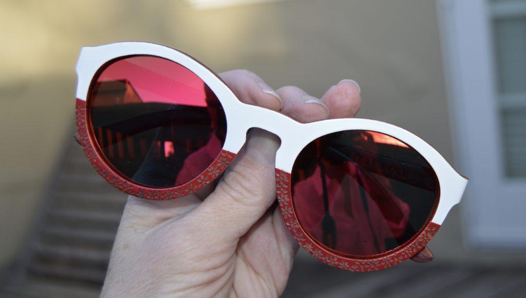 Winkwood Sunglasses close up, carved wooden eyewear