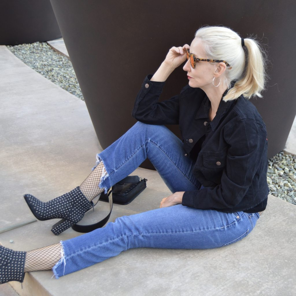 jeans, denim jacket, boots, and fishnets