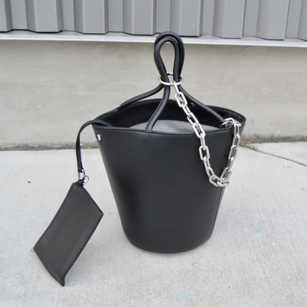 a review of a black leather bucket bag