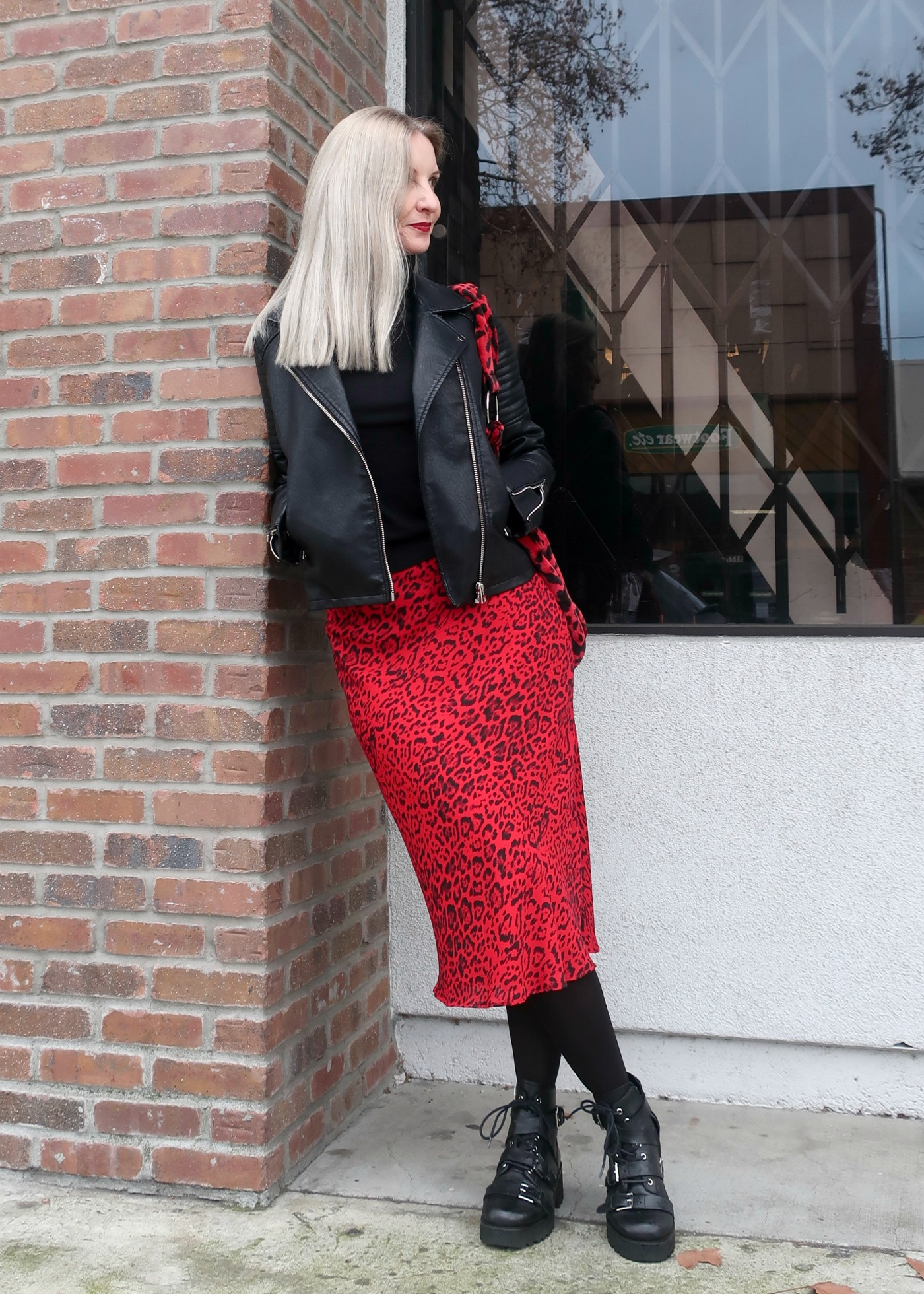 red leopard skirt and bag with moto jacket, edgy over 50