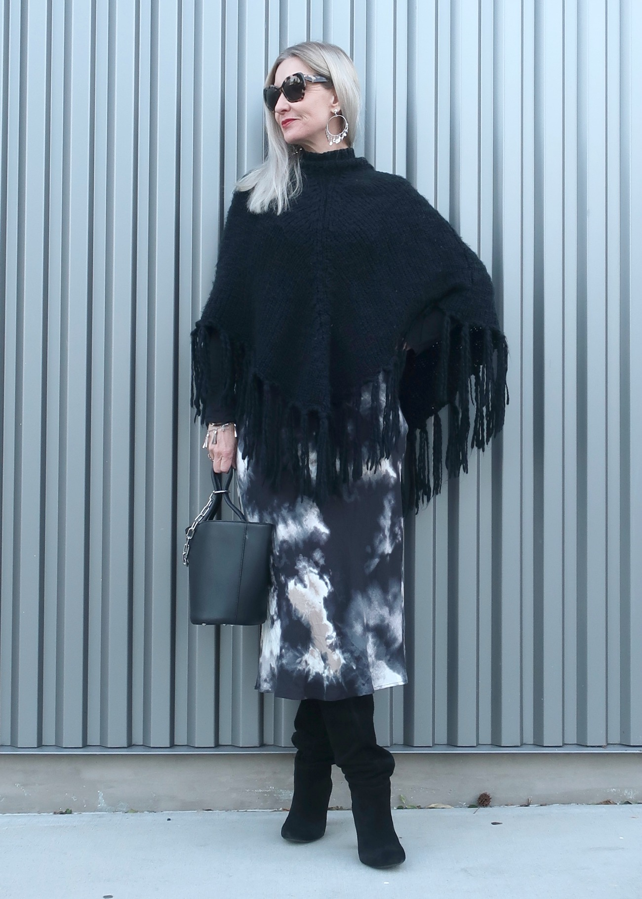 poncho, midi skirt, suede boots