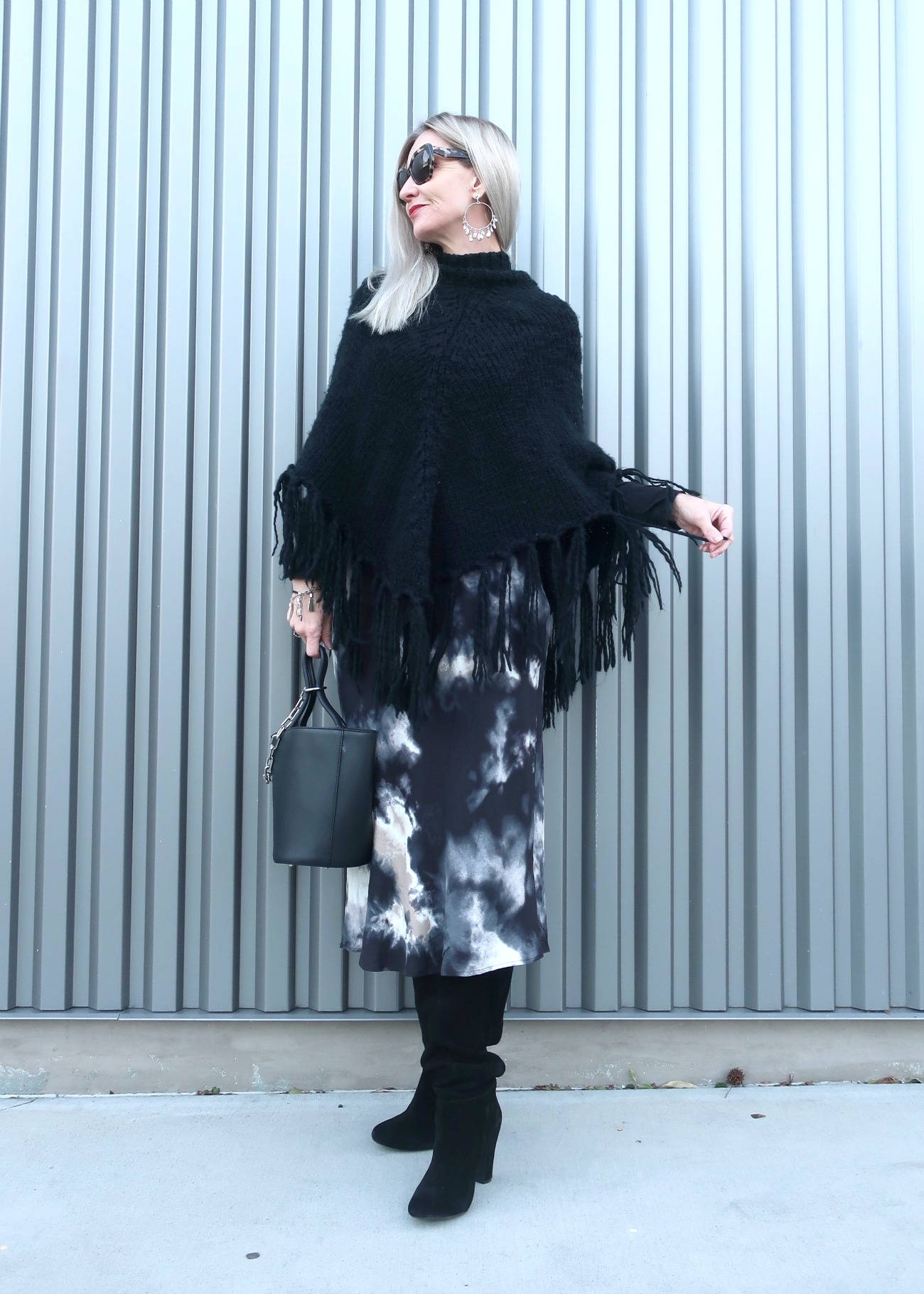 poncho and midi skirt and knee high boots