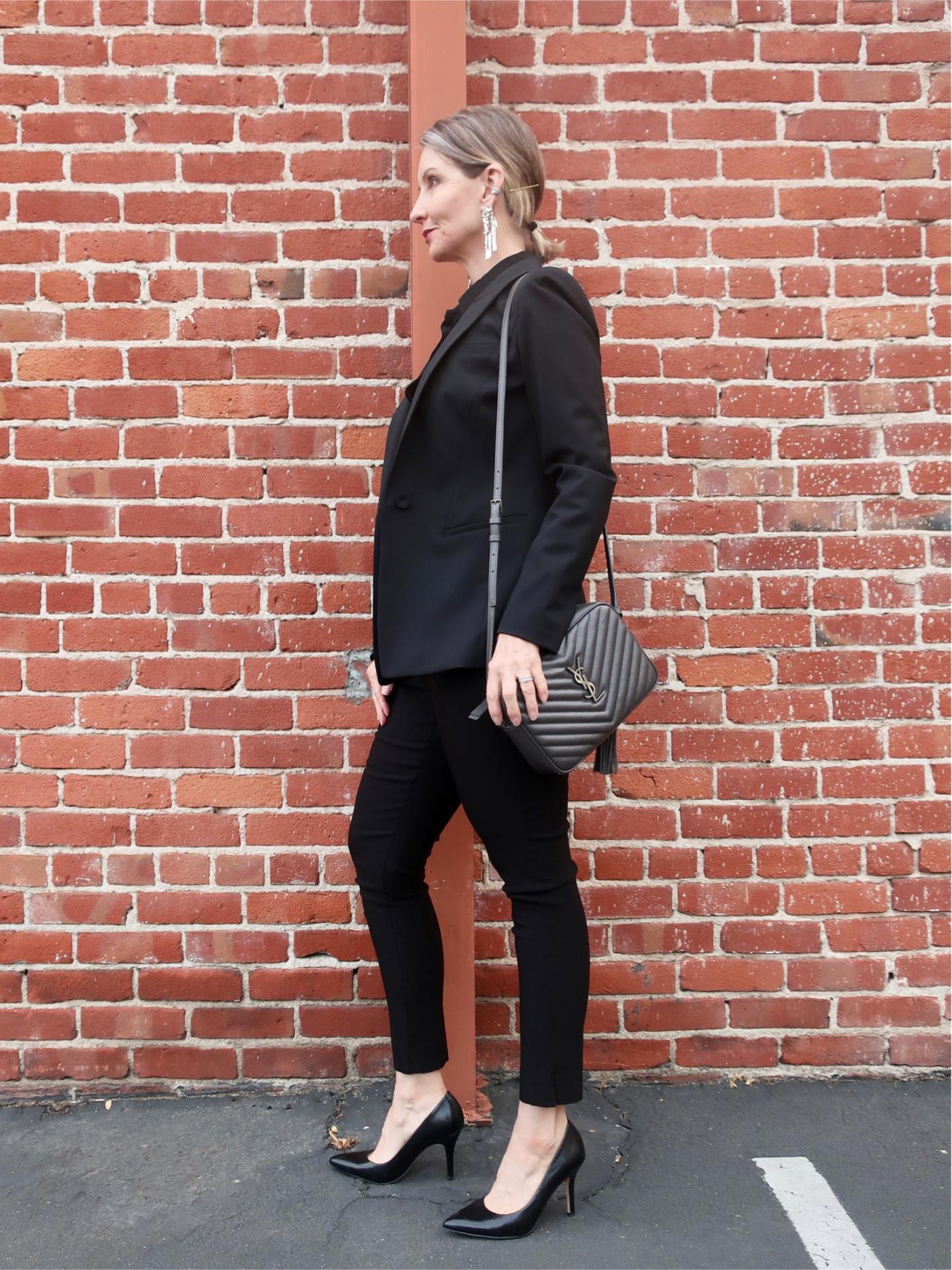 All black, statement earrings, YSL bag